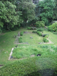 A view of a back garden from a second-story window.
